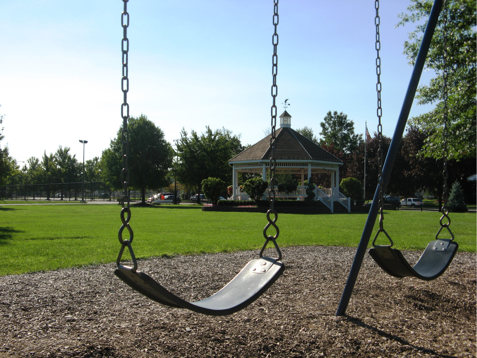 Photo of City Park facing southeast with swings and Gazebo in frame